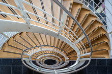 High Angle View Of Curved Stair Case Looking Down Making You Vertigo
