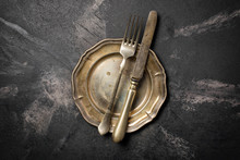 Vintage Silver Fork And Knife On Empty Plate
