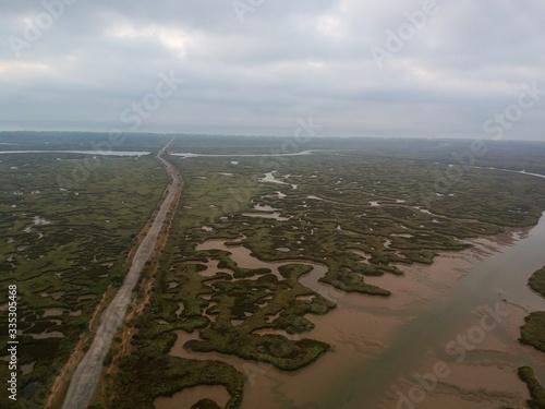 Fotografija Road in marshland