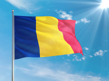 Romania National Flag Waving In The Wind Against Deep Blue Sky. High Quality Fabric. International Relations Concept.