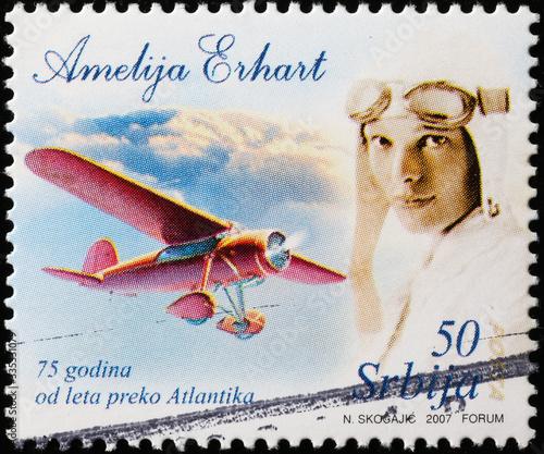 Flight across Atlantic of Amelia Earhart on postage stamp Canvas Print
