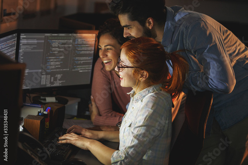 Obraz  Team of programmers working on new project.They working late at night at the office.  - fototapety do salonu