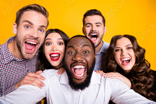 Obraz Closeup photo of gorgeous ladies guys five members company students graduation party best friends buddies make take selfies positive emotions expression isolated yellow color background - fototapety do salonu