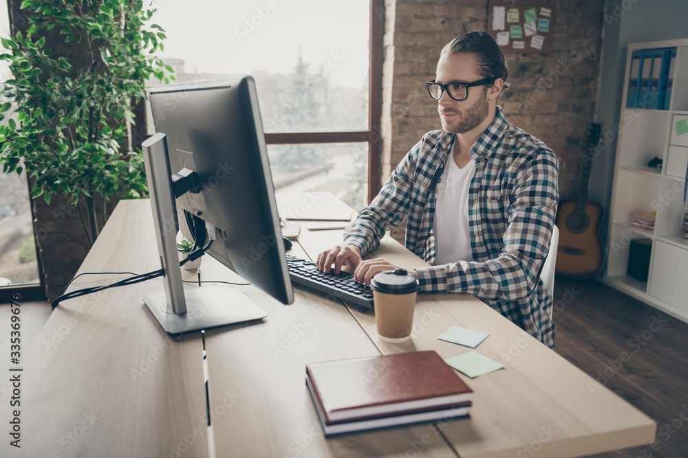 Fototapeta Photo of handsome business guy look computer monitor table chatting colleagues partners quarantine home remote working wear casual shirt suit sitting chair office indoors