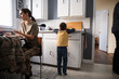 Soldier mother and son in kitchen