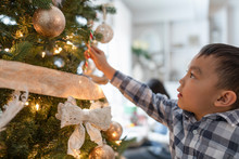 Boy Decorating Christmas Tree ...