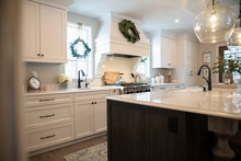 Kitchen With Christmas Wreaths On Windows