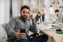 Business Owner Using Phone In ...