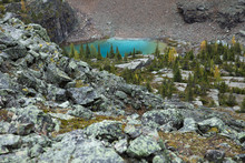 Scenic View Rugged Rocky Mountainside And Turquoise Blue Lake