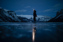Woman With Headlamp Ice Skatin...