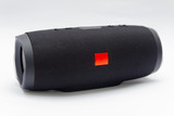 Black portable bluetooth speaker, with all-weather protection.