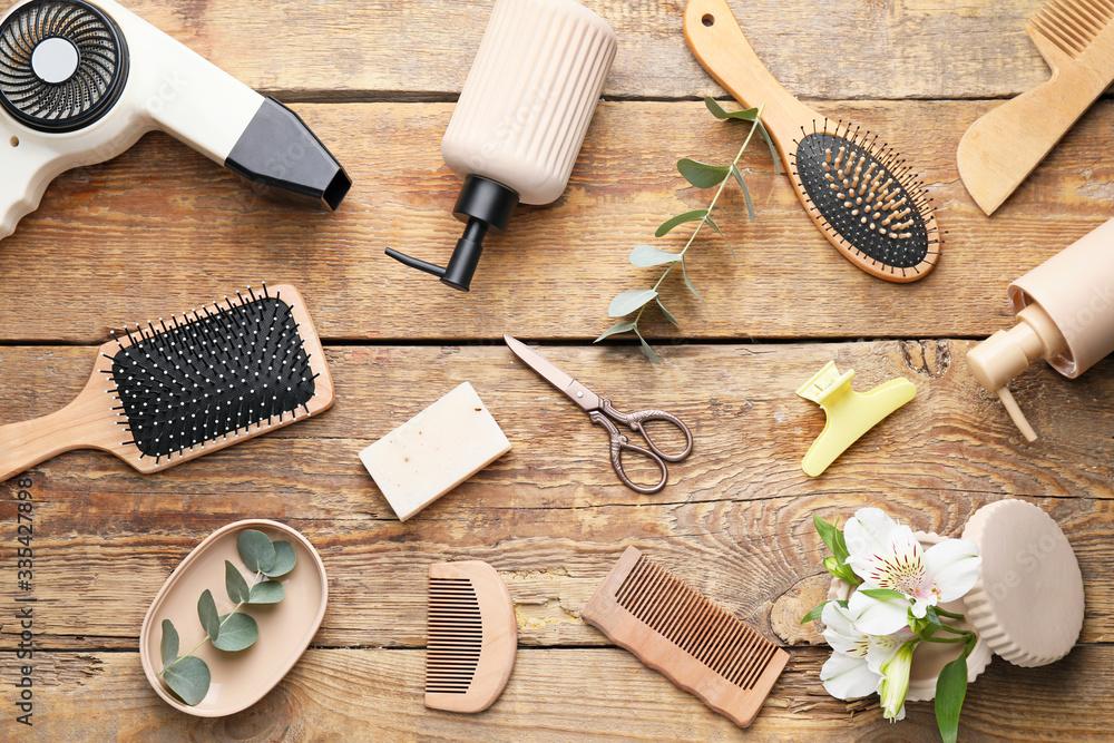 Fototapeta Set of hairdresser's accessories on wooden background