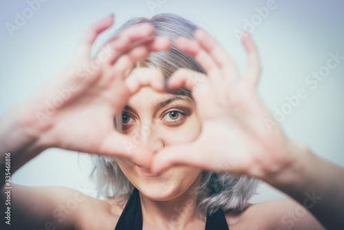Fototapeta woman making a hand heart frame obraz