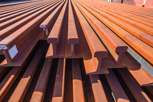 Railway New Steel Lines Tracks Stacked Outdoor Closeup Abstract Transport Manufacturing Infrastructure Equipment