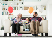 Muslim Family With Balloons Si...