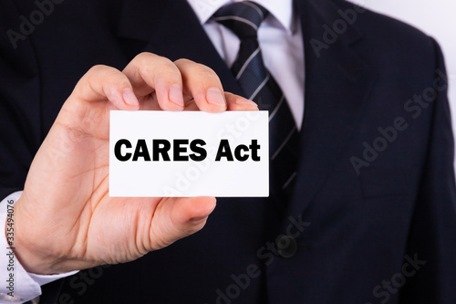 American businessman holds a card with the text CARES Act Canvas Print