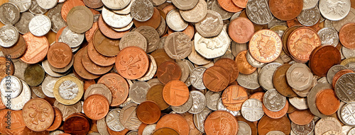 Fototapeta British currency, hundreds of copper and silver coloured coins piled randomly on top of each other, one pond coin, fifty pence, twenty pence, ten pence, five pence, two pence, one pence obraz