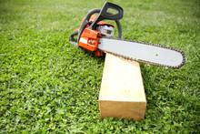 Orange Chainsaw On Grass Clos...