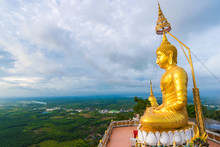 Big Golden Buddha Statue On Mountain With Cloud