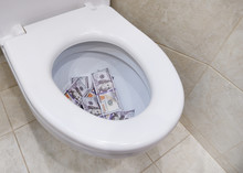 American Currency Of One Hundred Dollars In The Toilet. The Concept Of Losing Money. Unsuccessful Investment Of Finance. The Crisis.