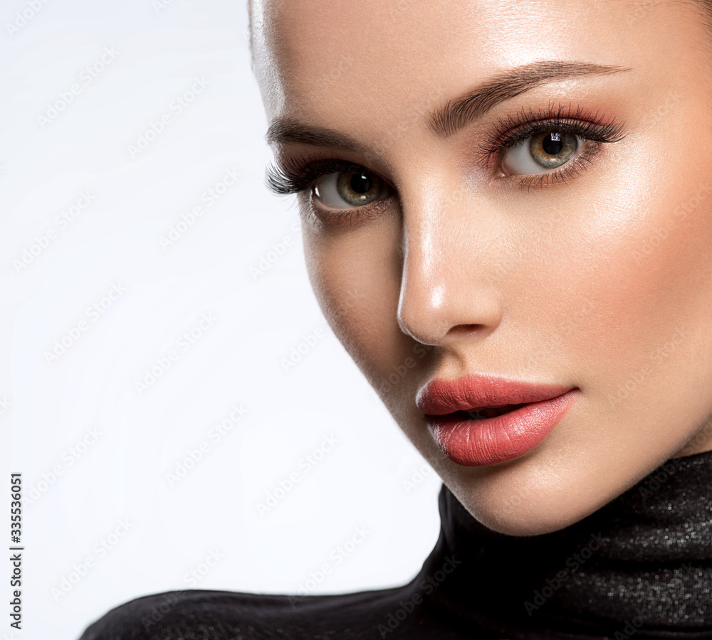 Fototapeta Portrait of beautiful young woman with bright pink makeup. Beautiful brunette with bright orange lipstick on her lips.
