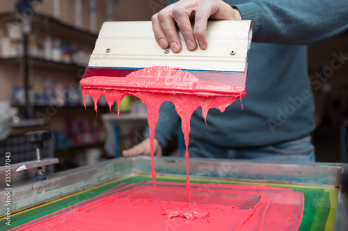 Obraz Silk screen printing. Serigraphy. Color paints and fabric. Plastisol paint and squeegee. - fototapety do salonu