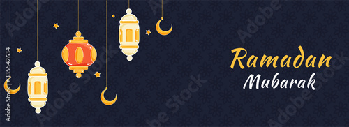 Islamic Holy Month of Ramadan Mubarak Banner with Hanging Colorful Lanterns, Golden Crescent Moon on Blue Textured Background Canvas Print