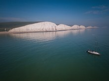 Aerial View Of  Seven Sisters Cliffs And Yacht, East Sussex, England
