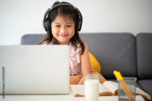 Vászonkép Asian girl using desktop computer for online study homeschooling during home quarantine