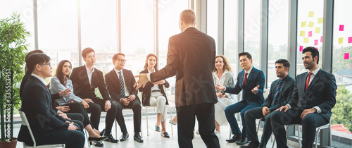 Fototapeta Business People Meeting Conference Discussion Corporate Concept in office. Team of newage Multiethnic Diverse Busy Business People in seminar Concept. obraz