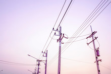 Electricity Pole Against Sunse...