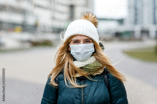 Fototapety, obrazy: The woman wears a protective mask from allergies, viruses, air pollution. Concept climate change.