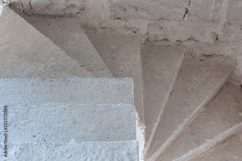Spiral concrete old staircase in an unfinished house © Дмитрий Соколов