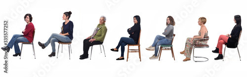 Obraz group of women sitting on chair on white background, side view - fototapety do salonu
