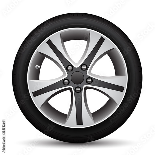 Foto Realistic car wheel alloy black tire on white background vector illustration