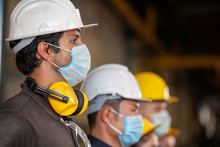 Workers Wear Protective Face M...