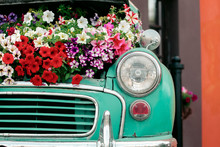 Mint Retro Car With Flowers Un...