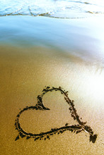 Beach. Heart Painted On Sea Sand