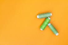 Green Spool Of Thread On A Yel...
