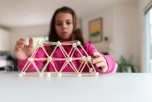 Young Girl Building A Structur...