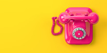Vintage Pink Telephone On Yellow Background.