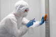 canvas print picture - Concept coronavirus disinfection. People in hazmats making cleaning in lift apartment
