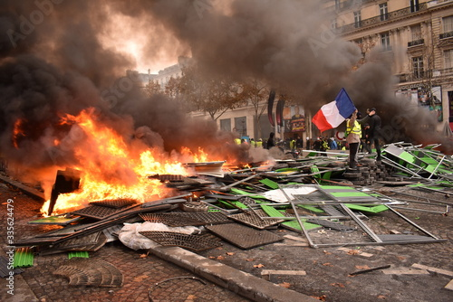 Pile of things burning on the street by yellow vest protestors in Paris France Canvas-taulu