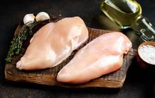 Raw Chicken Breast On A Cuttin...