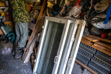 Person Man Standing Inside Garage Workshop Storage Room With Old Glass Cold Window Frames For Garden In Ukraine Dacha