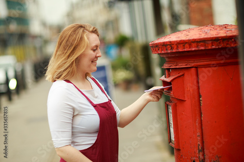Fototapeta young woman posting a letter