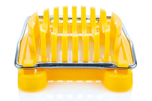 Manual Yellow Plastic Boiled Egg Cutter With Steel Wires On The Frame Isolated On White Background With Reflection On Glossy Surface. Front View