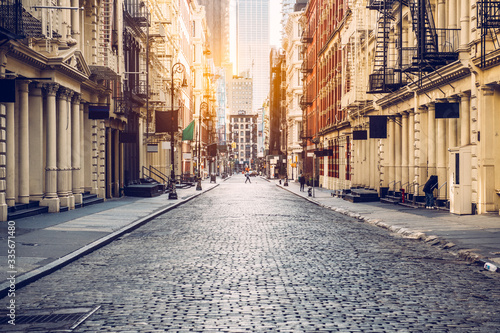 Fototapeta Empty street at sunset time in SoHo district in Manhattan, New York obraz