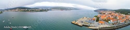 Aerial panoramic shot of buildings near the sea in Galicia, Spain