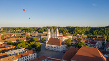 Beautiful Panoramic Aerial View Photo From Flying Drone On To Kaunas Franciscan Xavier Church And Kaunas City Hall With Flying Balloons In The Background Sky. Kaunas, Lithuania (series)